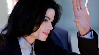 Michael Jackson waves to fans as he departs the Santa Barbara County Courthouse in Santa Maria, California May 25, 2005. Lawyers for Jackson rested their case Wednesday without calling the entertainer to testify in defense of the child molestation accusations against him. Jackson is charged with molesting a boy, then 13, at his   Neverland Valley Ranch in California in early 2003, plying the youth with alcohol in order to abuse him and conspiring to commit child abduction, extortion and false imprisonment. REUTERS/Lucas Jackson