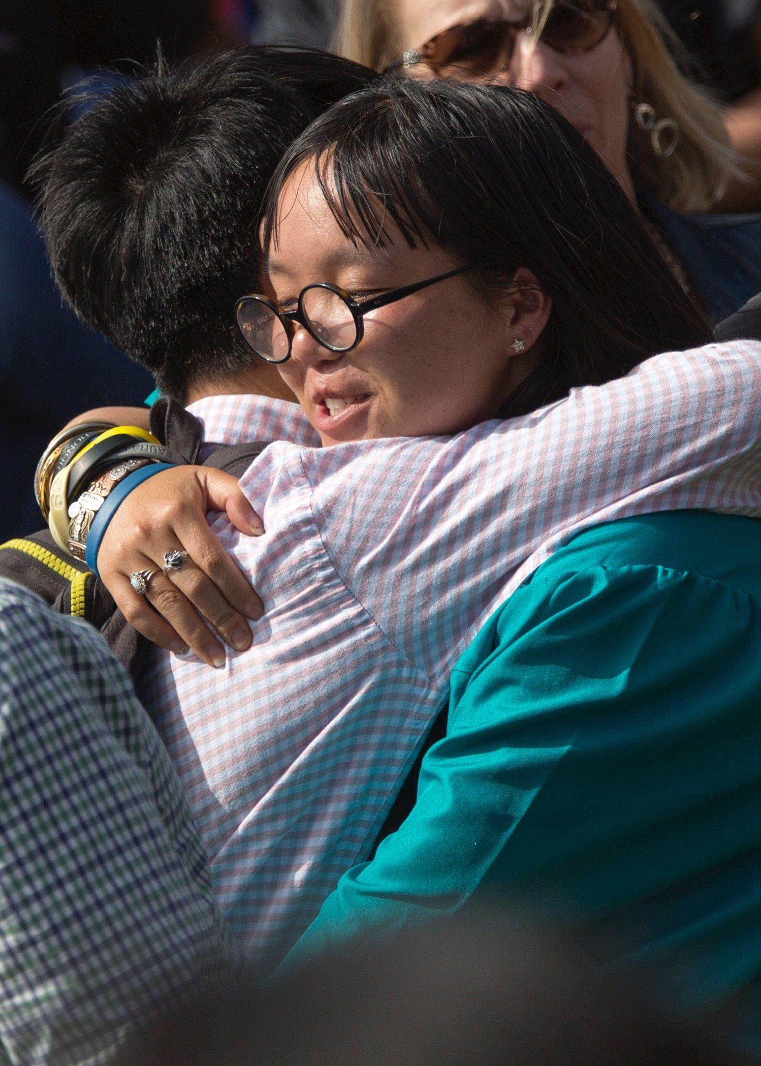 The author's children hugging one another at her daughter's recent graduation.