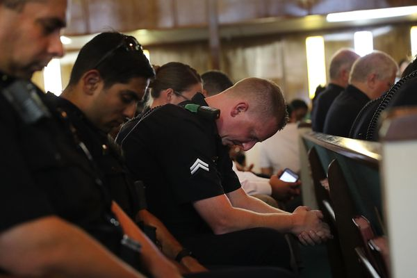 Roughlyadozen law enforcement officers filled the middle pews at Sunday's multicultural prayer vigil in Dallas.