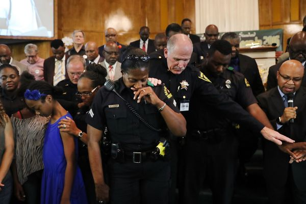 """At least 100people attended the vigil, according to <a href=""""http://www.dallasnews.com/news/crime/headlines/20160710-so"""
