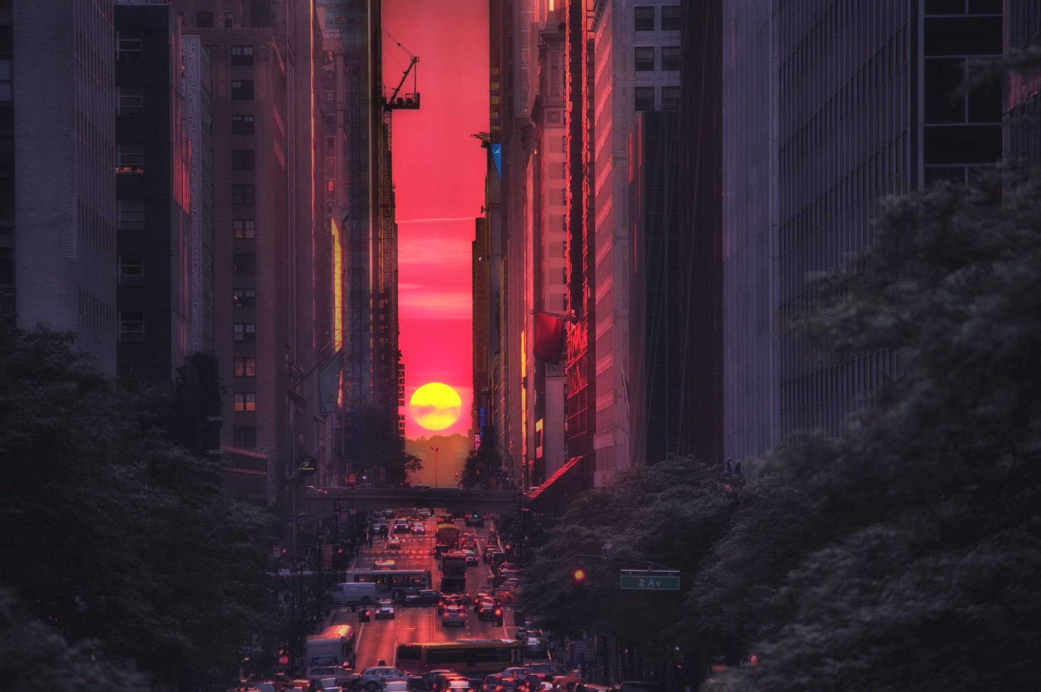 The best sunset ever! Manhattanhenge happends twice year every year. You can expect the photographers and tourists are all standing in middle of the street and trying to capture this amazing moment.Taken at Tudor City Place on 42nd st.