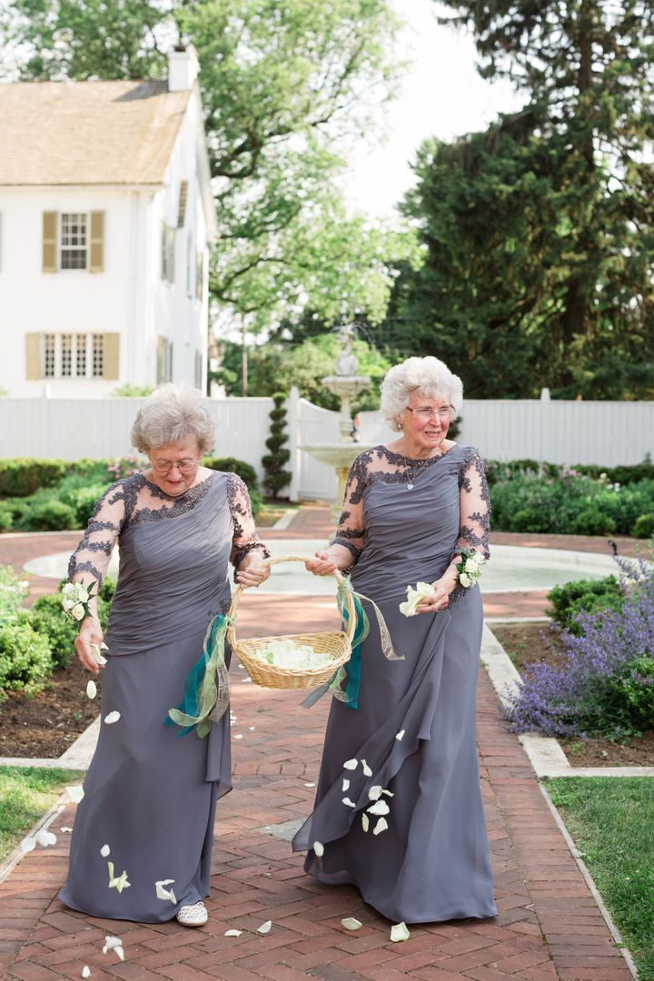 On the right, the bride's 75-year-old grandma Joyce. On the left, the groom's 74-year-old grandma Drue.
