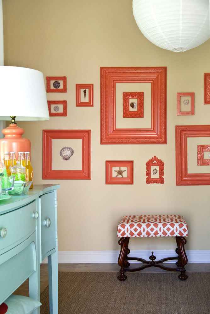 Glassless frames surround shells to create a mural.