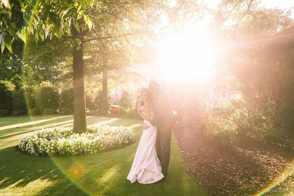 """""""Nancy and Jason as the sun sets on the Merrimon-WynneHouse where they got married yesterday in Raleigh, North Carolina"""