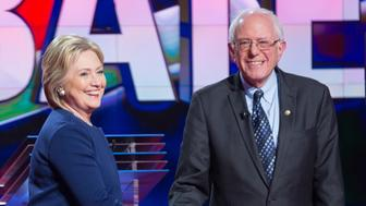 Democratic presidential candidates Hillary Clinton and Bernie Sanders shake hands at the start of the Democratic Debate in Flint, Michigan, March 6, 2016. / AFP / Geoff Robins        (Photo credit should read GEOFF ROBINS/AFP/Getty Images)