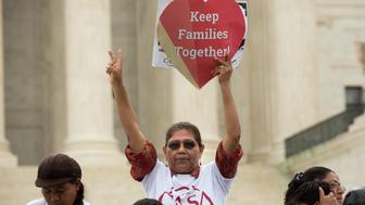 WASHINGTON, DC - JUNE 23: Antonia Surco, originally from Peru, holds a sign in front of the U.S. Supreme Court on a day where two important decisions on immigration and affirmative action were handed down by the court, on June 23, 2016 in Washington, DC.  The court was divided 4-4, leaving in place an appeals court ruling blocking Obama's immigration plan, which would have protected millions of immigrants from deportation. (Photo by Allison Shelley/Getty Images)