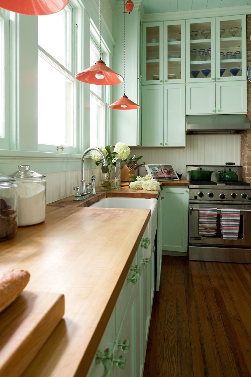 Mint green cabinets are a creative twist on traditional.