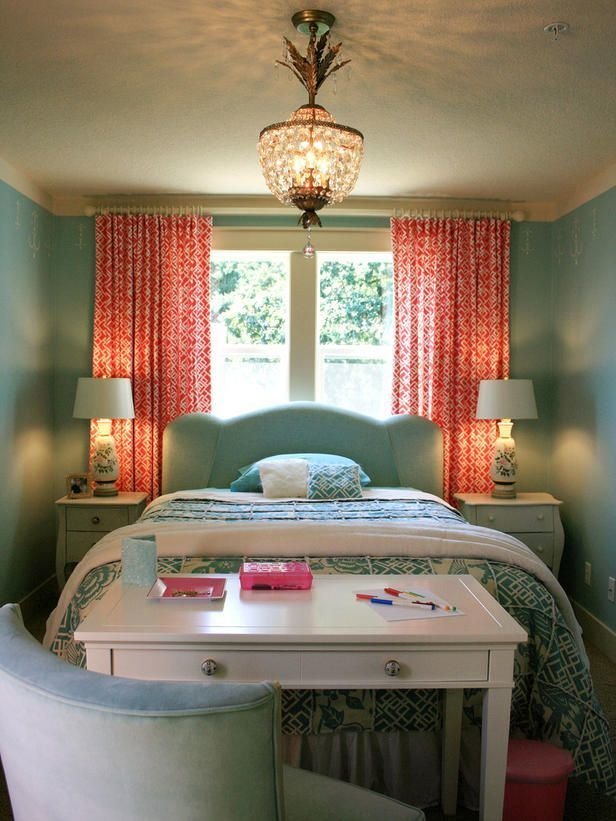 This eclectic bedroom uses coral as a bright accent.