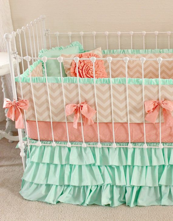 Mint green and coral create a soothing nursery.