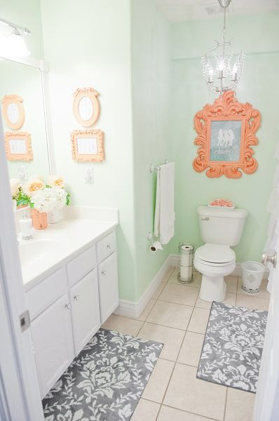 Mint green walls brighten in a bathroom.