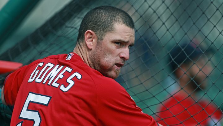 Former Red Sox player Jonny Gomes sucks on a wad of chewing tobacco in February 2014.
