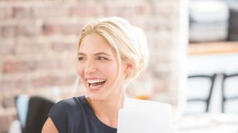 Woman laughing in office
