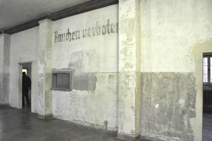 """""""On the walls, the pain had finally peeled off, years after Dachau was liberated to reveal an imprint: """"Rauchen verbote"""