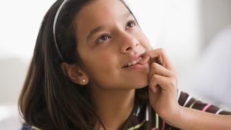 Hispanic girl thinking