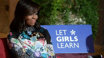 US first lady Michelle Obama smiles as she meets Moroccan young women following the 'Let Girls Learn' Program on June 28, 2016 in the Western Moroccan city of Marrakesh. US First Lady Michelle Obama began a two day visit to Morocco to participate in a CNN-moderated conversation with adolescent girls on the challenges they face in getting a quality education. / AFP / FADEL SENNA        (Photo credit should read FADEL SENNA/AFP/Getty Images)