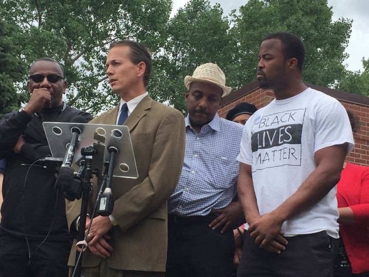 Falcon Heights Mayor Peter Lindstrom (at microphone) and Black Lives Matter organizer Rashad Turner (far right) speak outside