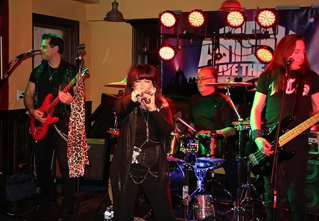 """Duane Belotti, Roberta """"Glert"""" Gold (lead vocalist), George Pagonis, Dean Anthony and Ken Gold (not shown)"""