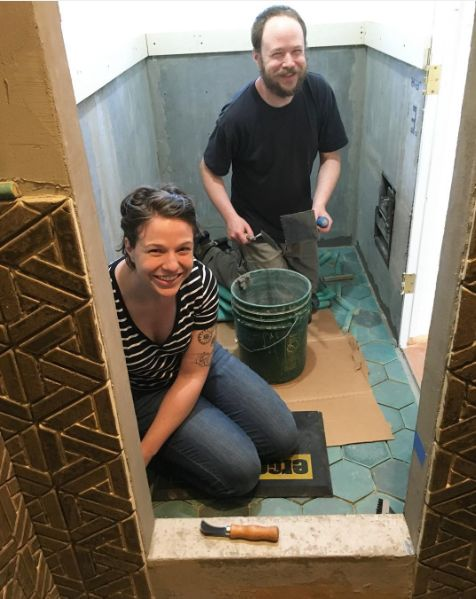 Me and Loren setting tile in a client's bathroom.