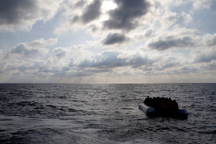 A humanitarian organization rescued hundreds of migrants from a wooden boat in the Mediterranean Sea on Tuesday. Pictured her