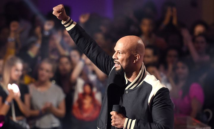 Common puts a fist in the air for black women at the VH1 Hip-Hop Honors on Monday.