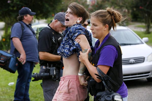 A demonstrator protesting the shooting death of Alton Sterling is detained by a law enforcement officer in Baton Rouge, Louis
