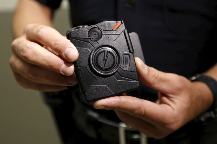 LAPD information technology bureau officer Jim Stover demonstrates the use of the body camera during a media event in Los Ang