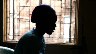A girl who trades sex for basic needs speaks during an interview with Reuters about HIV/AIDS at a health clinic within the Korogocho slum, in Kenya's capital Nairobi, February 16, 2015. Life can be brutal in Nairobi's slums, with alcoholic parents who fail to provide, or who push their daughters into the sex trade to feed the rest of the family. Girls as young as ten often have sex to survive, only to end up becoming mothers themselves -- infected with the same disease that robbed them of their parents. There are over 100,000 new HIV infections in Kenya each year, 21 percent of which are among girls and women aged between 15 and 24, said Lilian Otiso, director of services for LVCT, a Kenyan charity providing HIV/AIDS and sexual health services to children trading sex for basic needs in Nairobi slums. Picture taken February 16, 2015. REUTERS/Katy Migiro (KENYA - Tags: HEALTH)