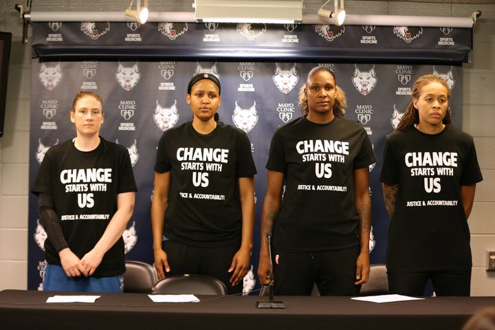 Lindsay Whalen #13, Maya Moore #23, Rebekkah Brunson #32, and Seimone Augustus #33 of the Minnesota Lynx attend a press confe