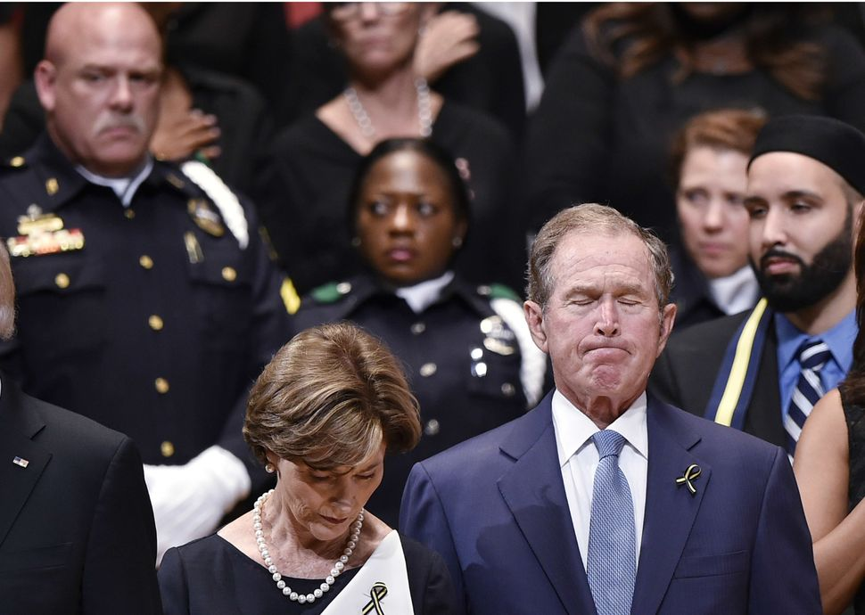 Former President George W. Bush and former first lady Laura Bush attended the service.
