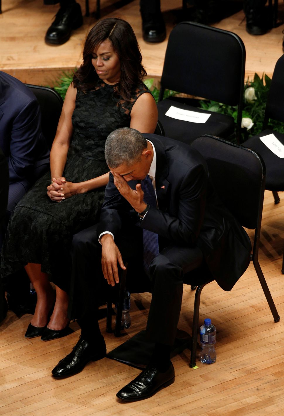 Obama puts his hand to his eyes during the service.