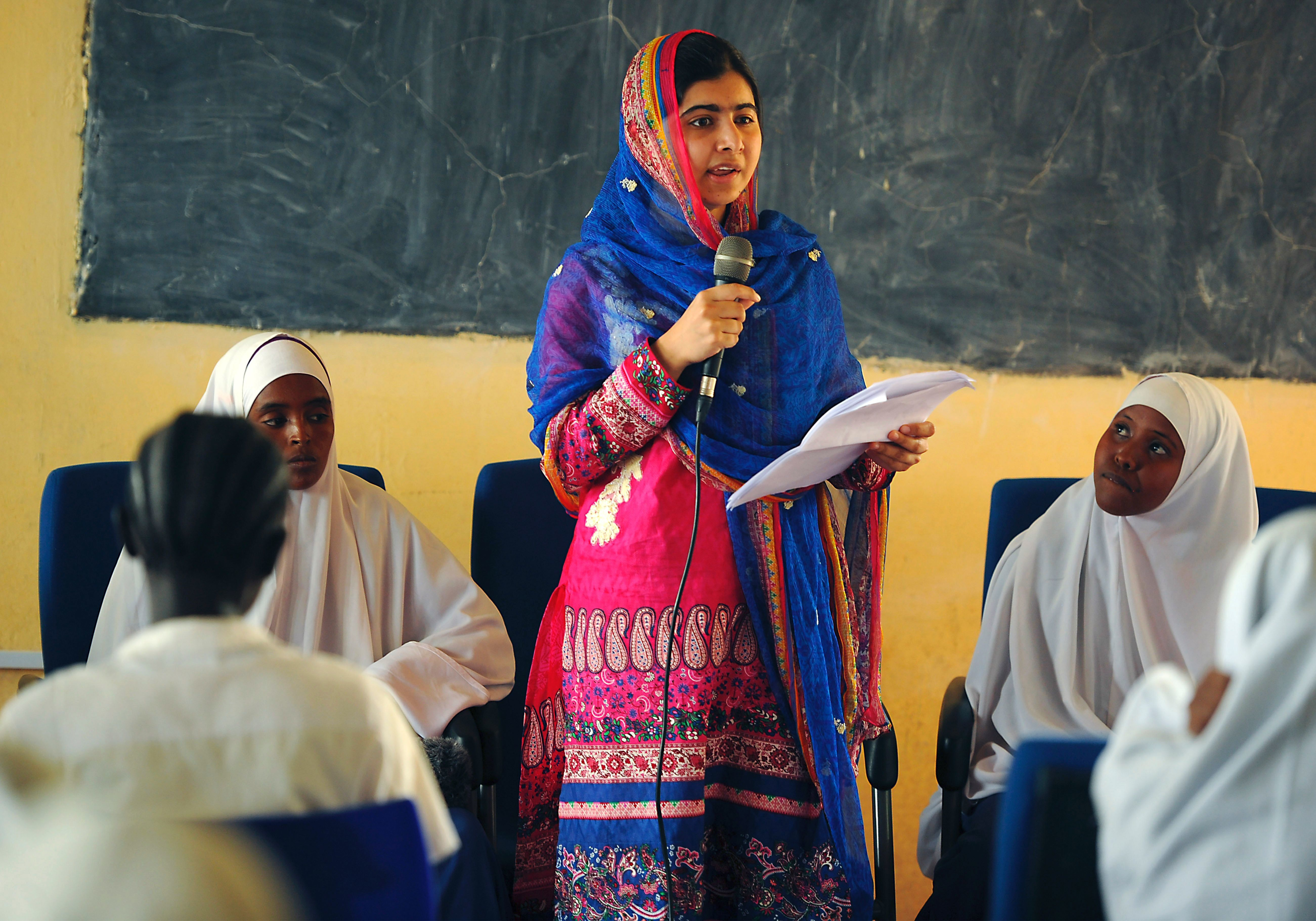 Pakistani activist for female education and the youngest-ever Nobel Prize laureate Malala Yousafzai addresses young refugees at Kenya's sprawling Dadaab refugee complex during a visit organised by the UN High Commissioner for Refugees, in Garissa on July 12, 2016. / AFP / TONY KARUMBA        (Photo credit should read TONY KARUMBA/AFP/Getty Images)