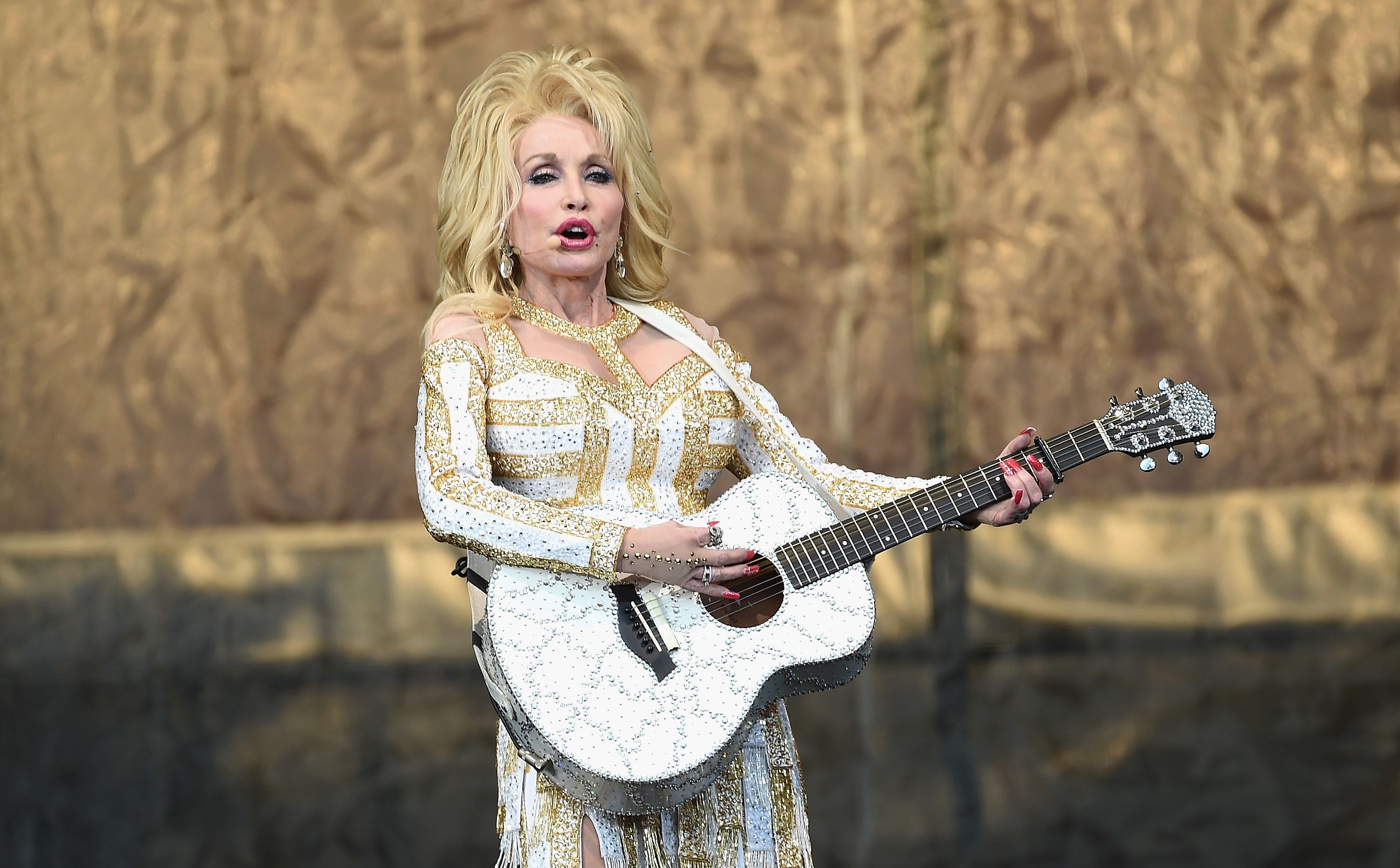 NEW YORK, NY - JUNE 25:  Country music recording artist Dolly Parton performs on stage during the 'Pure & Simple' tour at Forest Hills Stadium on June 25, 2016 in New York City.  (Photo by Gary Gershoff/Getty Images)