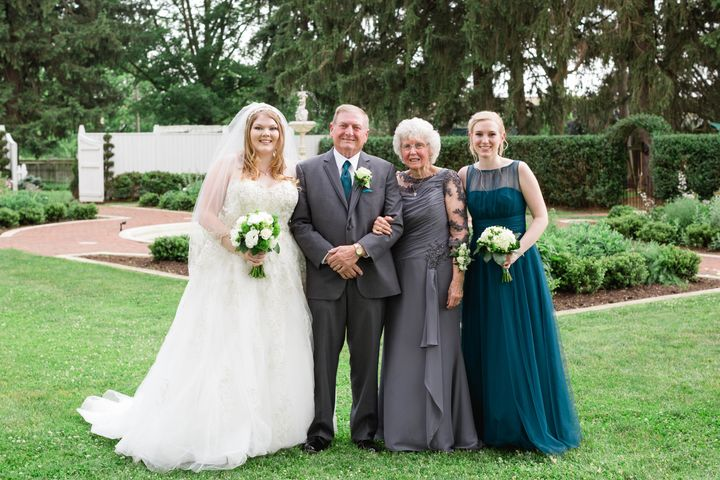 The bride with her paternal grandparents and her sister Bethany.