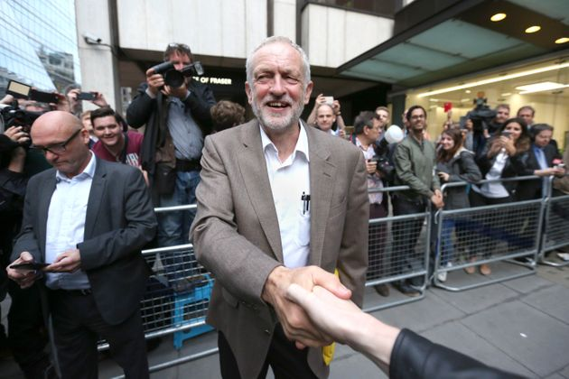 Jeremy Corbyn leaves Labour HQ after being told he would automatically be on the