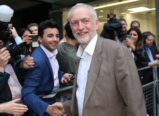 Corbyn shook hands and spoke with jubilant supporters who chanted his
