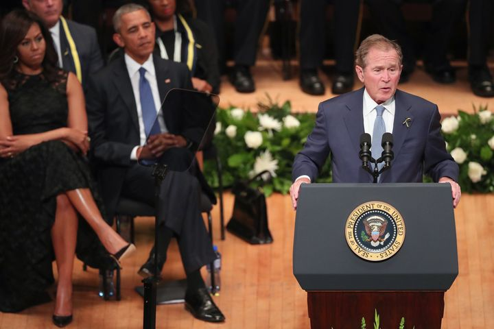 Former President George W. Bush delivers remarks during an interfaith memorial service, honoring five slain police officers,
