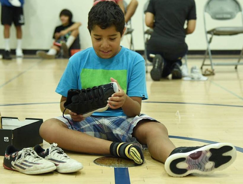 Diego is thrilled to receive his first pair of basketball shoes from Hav A Sole