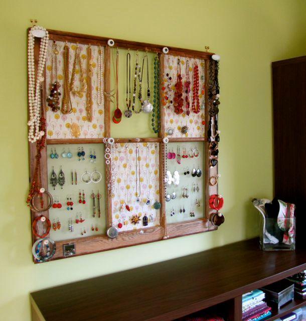 <i>A window is used as a jewelry organizer.</i>