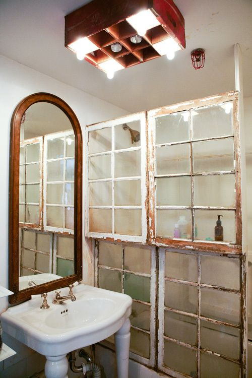 <i>Windows are fashioned to make a shower enclosure.</i>