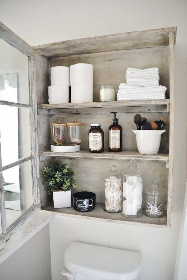<i>A window made into a cabinet adds space in the bathroom.</i>