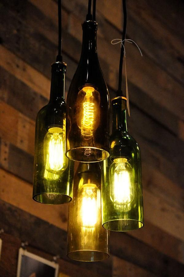 <i>A chandelier is made from old wine bottles</i>.