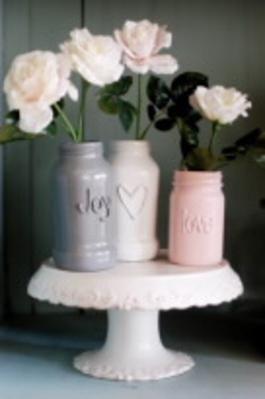 <i>Paint and hot glue transform sauce jars.</i>