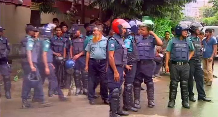 Police gather after gunmen attacked the Holey Artisan restaurant and took hostages early on Saturday, in Dhaka, Bangladesh in