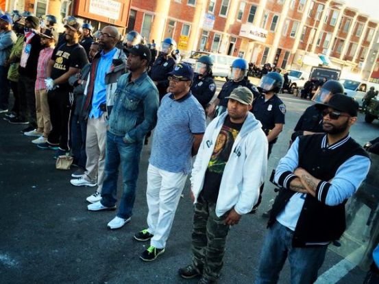 During the 2015 Baltimore protests, citizens formed a line in front of police officers to form a peaceful barrier between law