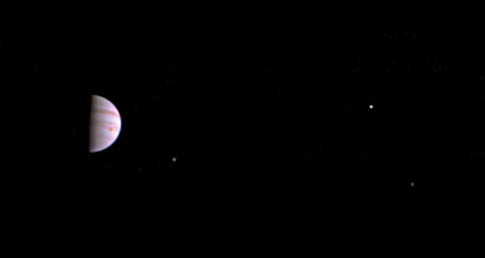 Jupiter and its Great Red Spot can be seen in this first image released by NASA. From left to right,...