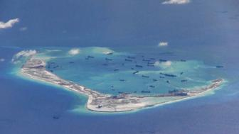 """Chinese dredging vessels are purportedly seen in the waters around Mischief Reef in the disputed Spratly Islands in the South China Sea in this still image from video taken by a P-8A Poseidon surveillance aircraft provided by the United States Navy May 21, 2015.  U.S. Navy/Handout via Reuters/File Photo  ATTENTION EDITORS - THIS PICTURE WAS PROVIDED BY A THIRD PARTY. REUTERS IS UNABLE TO INDEPENDENTLY VERIFY THE AUTHENTICITY, CONTENT, LOCATION OR DATE OF THIS IMAGE. THIS PICTURE IS DISTRIBUTED EXACTLY AS RECEIVED BY REUTERS, AS A SERVICE TO CLIENTS. EDITORIAL USE ONLY. NOT FOR SALE FOR MARKETING OR ADVERTISING CAMPAIGNS  FROM THE FILES PACKAGE - SEARCH """"SOUTH CHINA SEA FILES"""" FOR ALL IMAGES"""
