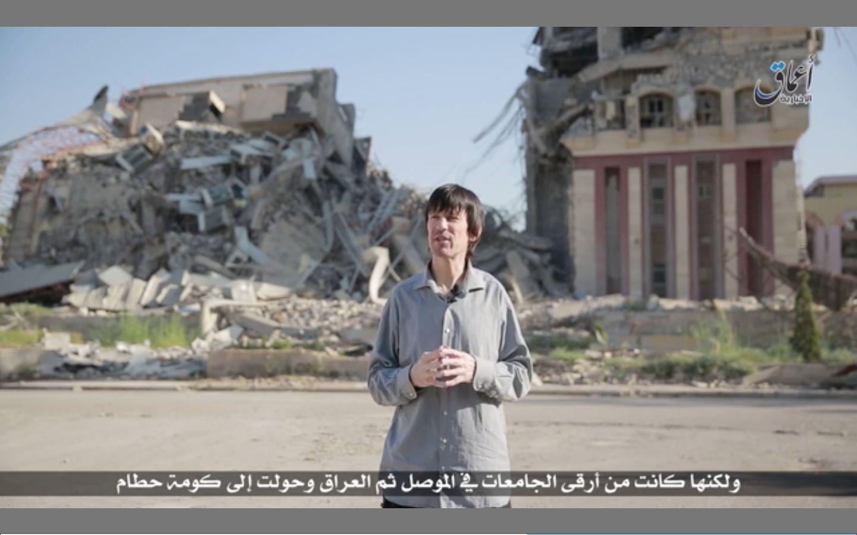 Pale and gaunt-looking British journalist John Cantlie, kidnapped in November 2012 by hardline rebels...