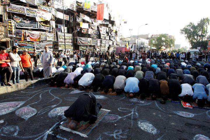 Sunni and Shi'ite Muslims attend prayers in Baghdad on July 6 during Eid al-Fitr as they mark the end of the Muslim holy&nbsp