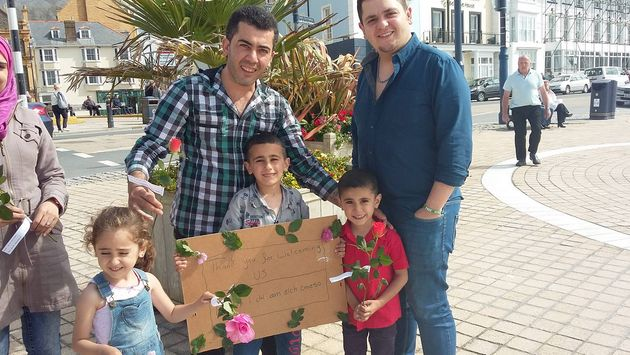 Syrian refugees in Aberystwyth handed out flowers of gratitude to thanks locals for welcoming them to...