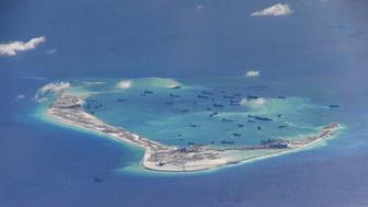 "Chinese dredging vessels are purportedly seen in the waters around Mischief Reef in the disputed Spratly Islands in the South China Sea in this still image from video taken by a P-8A Poseidon surveillance aircraft provided by the United States Navy May 21, 2015.  U.S. Navy/Handout via Reuters/File Photo  ATTENTION EDITORS - THIS PICTURE WAS PROVIDED BY A THIRD PARTY. REUTERS IS UNABLE TO INDEPENDENTLY VERIFY THE AUTHENTICITY, CONTENT, LOCATION OR DATE OF THIS IMAGE. THIS PICTURE IS DISTRIBUTED EXACTLY AS RECEIVED BY REUTERS, AS A SERVICE TO CLIENTS. EDITORIAL USE ONLY. NOT FOR SALE FOR MARKETING OR ADVERTISING CAMPAIGNS  FROM THE FILES PACKAGE - SEARCH ""SOUTH CHINA SEA FILES"" FOR ALL IMAGES"